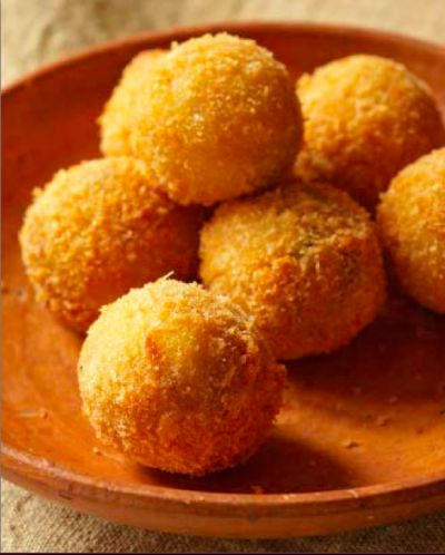 <i>Croquetas</i> are one of Latin America's favorite treats. These ham and cilantro croquettes from Puerto Rican cookbook <i> Cocina Tropical. </i>