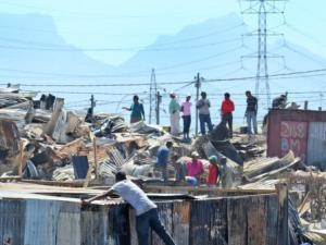 Picking up the pieces after fires in Khayelitsha on New Year's Day, destroying more than 800 shacks and killing 3. More than 650 people are staying in shelters, while others are trying to rebuild.