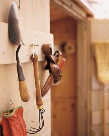 Small tools such as trowels, hand cultivators, and pruners can get lost on shelves or in bins. Keep them on the inside of your shed door instead. Drill 1/4-inch holes into the door's crosspiece or into a 1-by-6 attached to the wall; cover the bottom half of 1/4-inch pegs with wood glue, and insert them into the holes. Let the glue set before hanging up items. To hang a tool with a handle but no strap, install two pegs: Drill two holes, spaced to fit the handle's thickness, then glue in pegs.