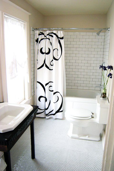 DIY network Rehab Addict - Love the subway and hex tiles with black grout for an older bathroom remodel
