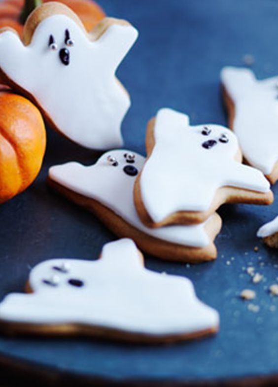 Halloween Ghost Biscuits. Try your hand at making these easy iced biscuits – spook your fiends and family!