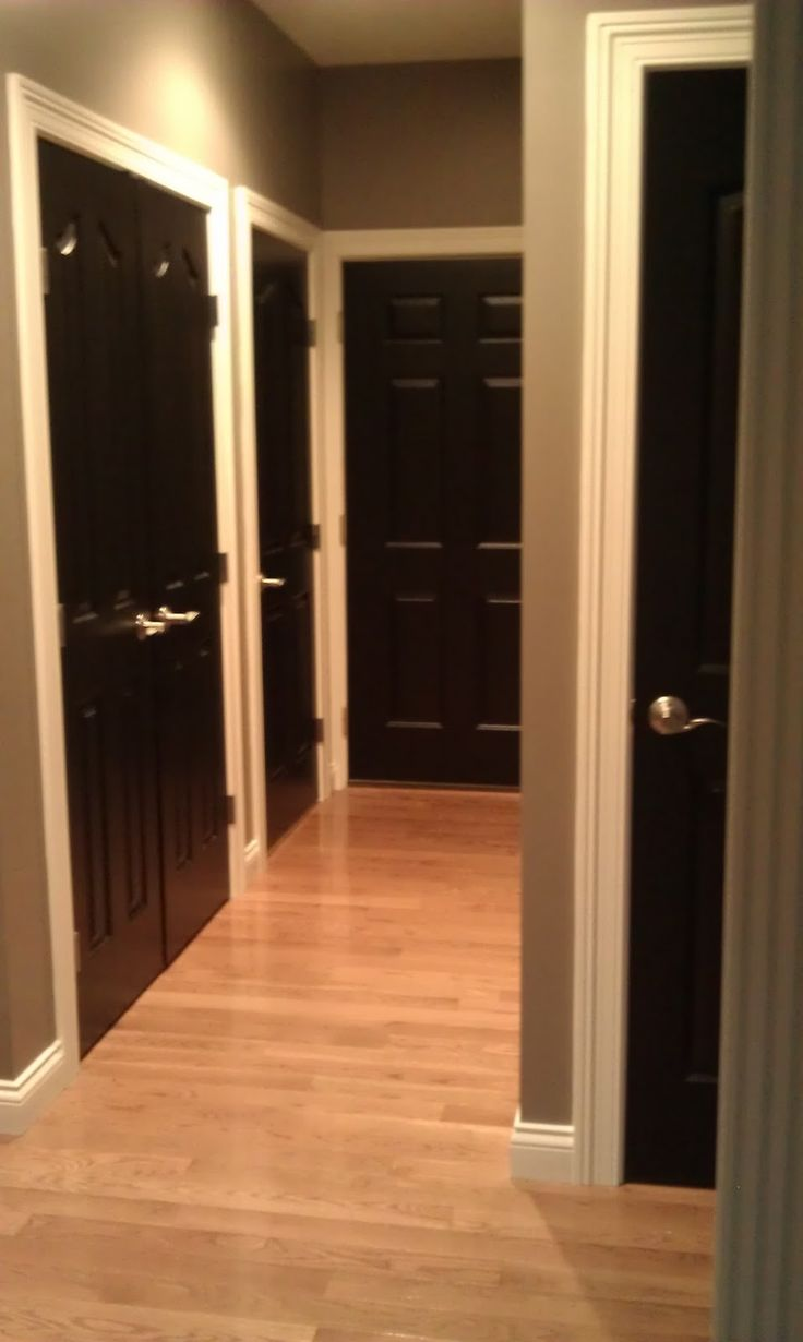 Black Doors  Brown vs Black Interior Doors  Brushed silver knobs   LIGHTER HARDWOOD UPSTAIRS