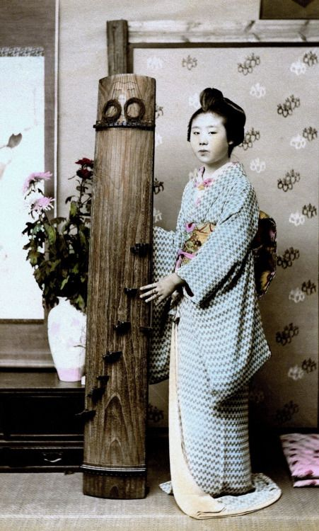"This circa 1880s-90s Geisha is standing next to Japan's ""National Musical Instrument"" — the KOTO"
