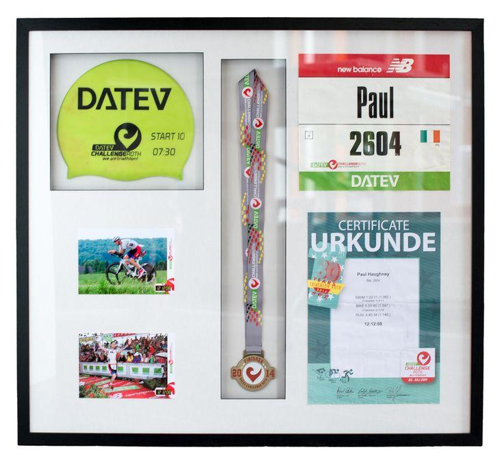 Framed swim cap, medal, certificates and photos from triathlon / iron man.