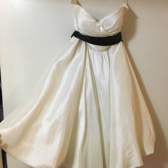 Shop Women's White Black size 2 Prom at a discounted price at Poshmark. Description: White knee length dress for special occasions whit black ribbon around rib cage size 2. Sold by ashketchumall. Fast delivery, full service customer support.