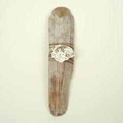 Driftwood, silk thread, shell fragment, pearls. Adelaide Shalhope. 2012