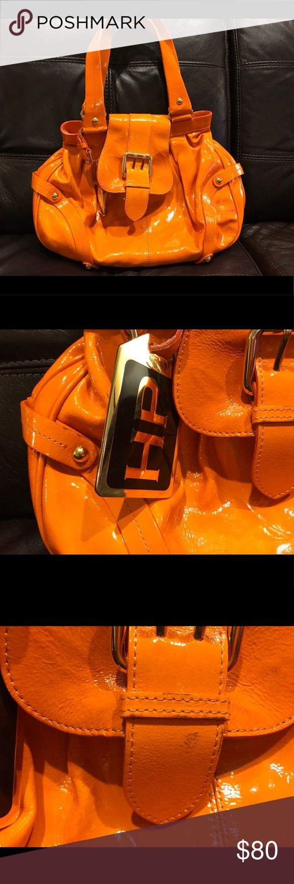 Dooney & Bourke Patent Leather Shoulder Bags Authentic Dooney & Bourke Hayden Panettiere HP Orange Shoulder Bag.  Good Condition. Some Ink Stains Shown In The Picture ( stains may be removed with rubbing alcohols or hairspray) Dooney & Bourke Bags Shoulder Bags