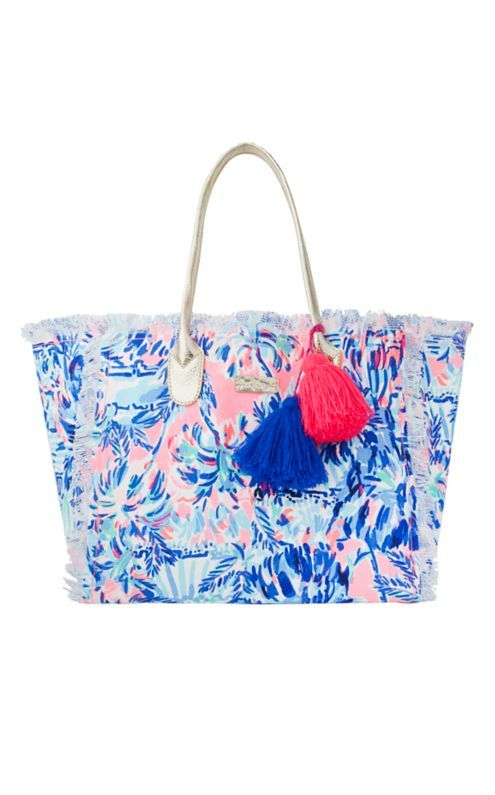 The Gypset Frayed Beach Tote is the ultimate beach bag. This printed canvas bag is package and durable. Load it up for days spent at the beach and pack it into your suitcase when you head home. The fray details and tassels make this an update classic!