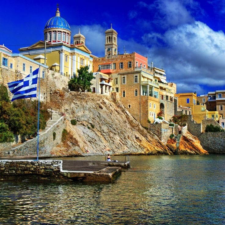 Majestic temple by a small port in Syros island, Greece
