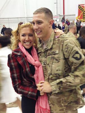 """Nick from PA """"This picture is from my return ceremony from Afghanistan. I had given my girlfriend the same exact locket before I left and it kept her company while I was gone. But she lost it so I am going to get her the same exact one again only with a new coming home picture inside""""."""