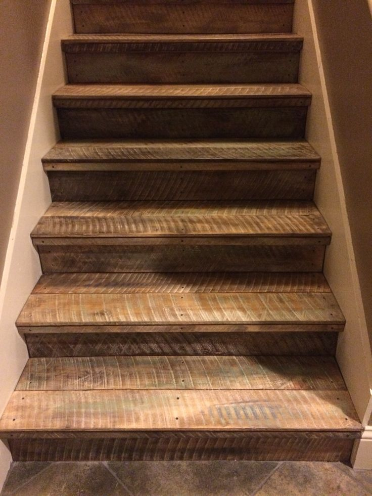 Rough cut untreated pine, then painted and stained - love the way these rustic pallet wood stairs are turning out.