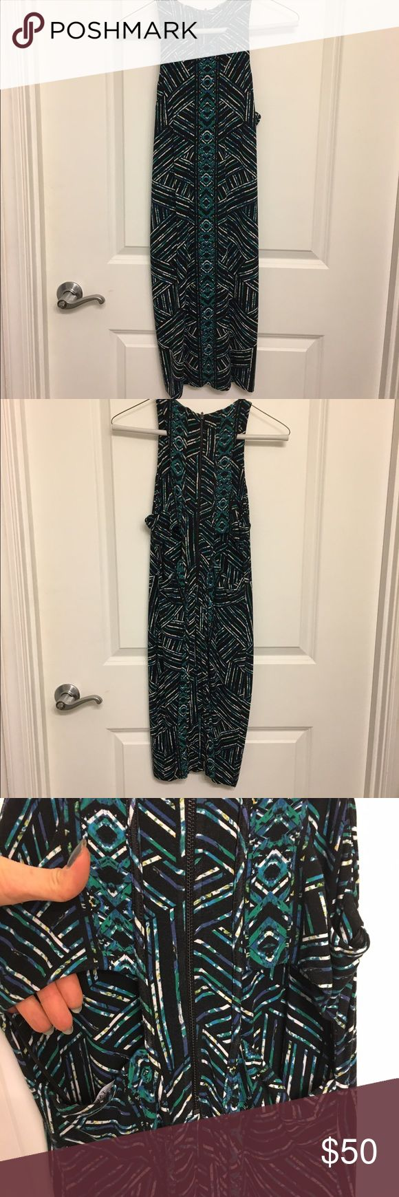 Tart multi dimensional color dress About 33 inches from shoulder to hemline.  Multi color (blue,green, white and black print) cut outs in the back.  Sexy, going out dress. Nice, semi thick, quality material.  Worn once. Tart Dresses Mini