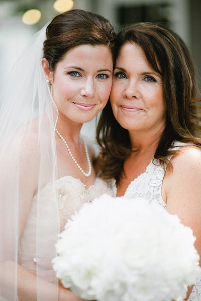 This mother-daughter duo flash the same subtle but glowing smile. Photo Credit: Lauren Larsen on Southern Weddings via Lover.ly