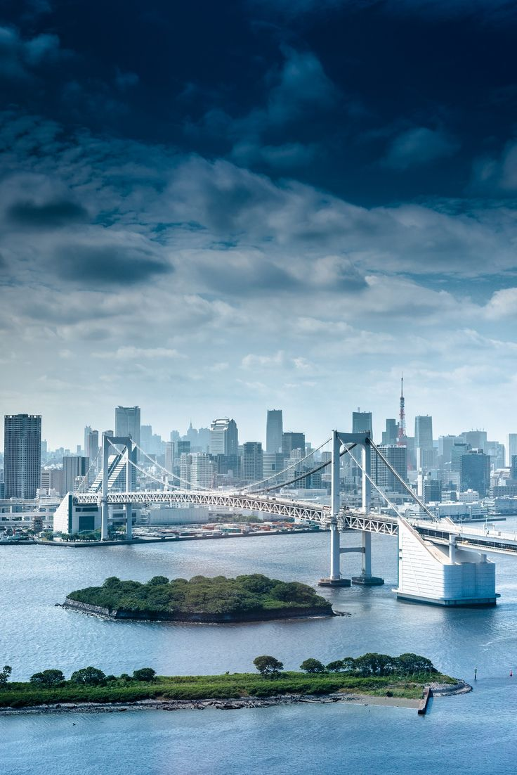 Tokyo's Rainbow Bridge, a suspension bridge spanning Tokyo Bay to connect Shibaura Wharf and the Odaiba waterfront area, is one of the city's most recognizable landmarks, particularly at night.
