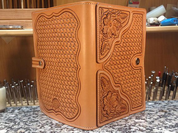 Thank you for your interest in my shop. This is my newest ipad case design. It is fully hand tooled front and back with hand tooled leather plates in floral pattern. It has a magnetic latch closer and fits all buttons and ports on an ipad 2. This is a unique and top of the line case