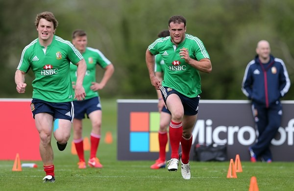 Jonathan Davies and Jamie Roberts being pushed through the passes during lions training.