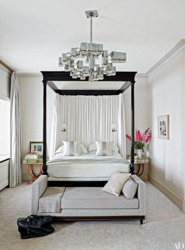 In the master bedroom of this London rowhouse by Veere Grenney, a 1970s Gaetano Sciolari light fixture from Galerie Yves Gastou joins a Veere Grenney Assoc. ebonized four-poster and a Francis Sultana daybed; the curtains are made of a Zimmer + Rohde silk, and the carpet is by Tai Ping | archdigest.com