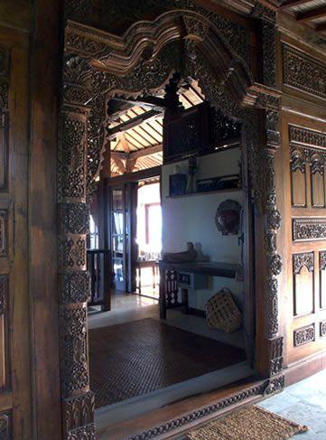 Carved wooden walls at Villa Citakara Sari, East Bali, Indonesia