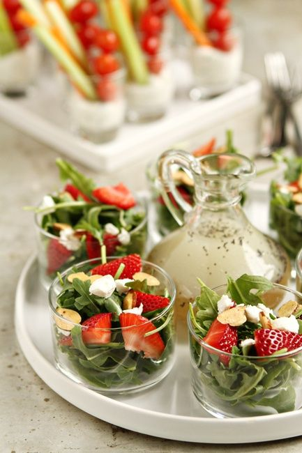 Strawberry Salad with Poppy Seed Dressing: For the Dressing  1/2 cup granulated sugar  1 tablespoon poppy seeds  2 teaspoons finely grated Vidalia onion  1/4 cup white wine vinegar  1/4 cup apple cider vinegar  1/2 cup vegetable oil    For the Salad  5 ounces (about 4 cups) baby arugula  1 cup sliced strawberries  1/3 cup crumbled goat cheese  1/4 cup sliced almonds