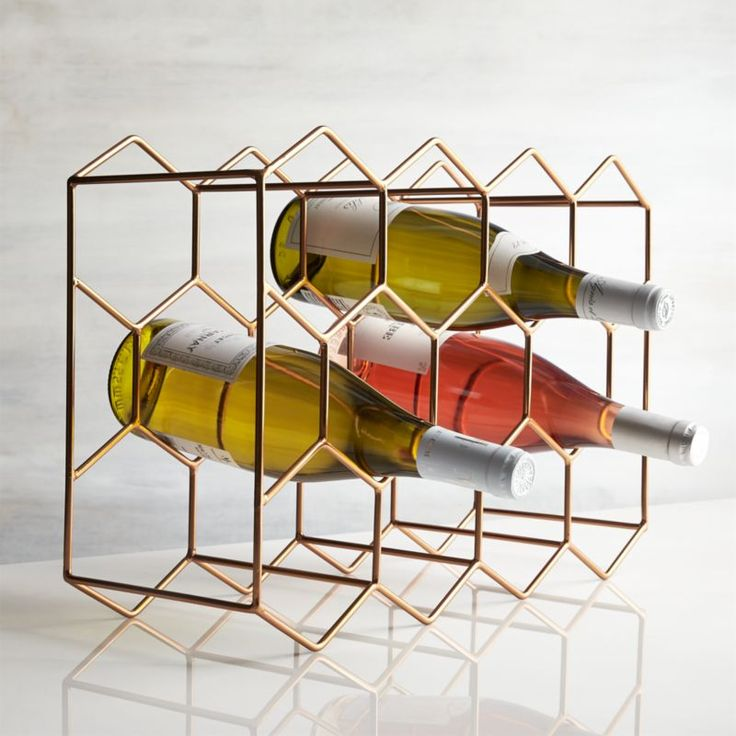 Shop 11-Bottle Wine Rack Copper.  Geometric wine rack creates a coppery hive for 11 wine bottles.  Crafted of slim iron rods hand welded into place, the rack lends a contemporary artful presence to the kitchen countertop, wine cabinet or bar.