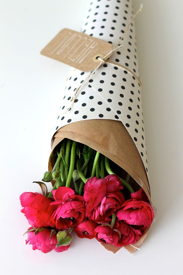 Wrap flowers in some polka dot paper and add your own gift tag and tie with twill or some kind of string for a more special look :)