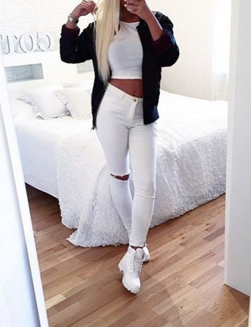 cropped top + high-waisted ripped white jeans + black jacket = chic street style outfit idea | fashion trends | casual outfit