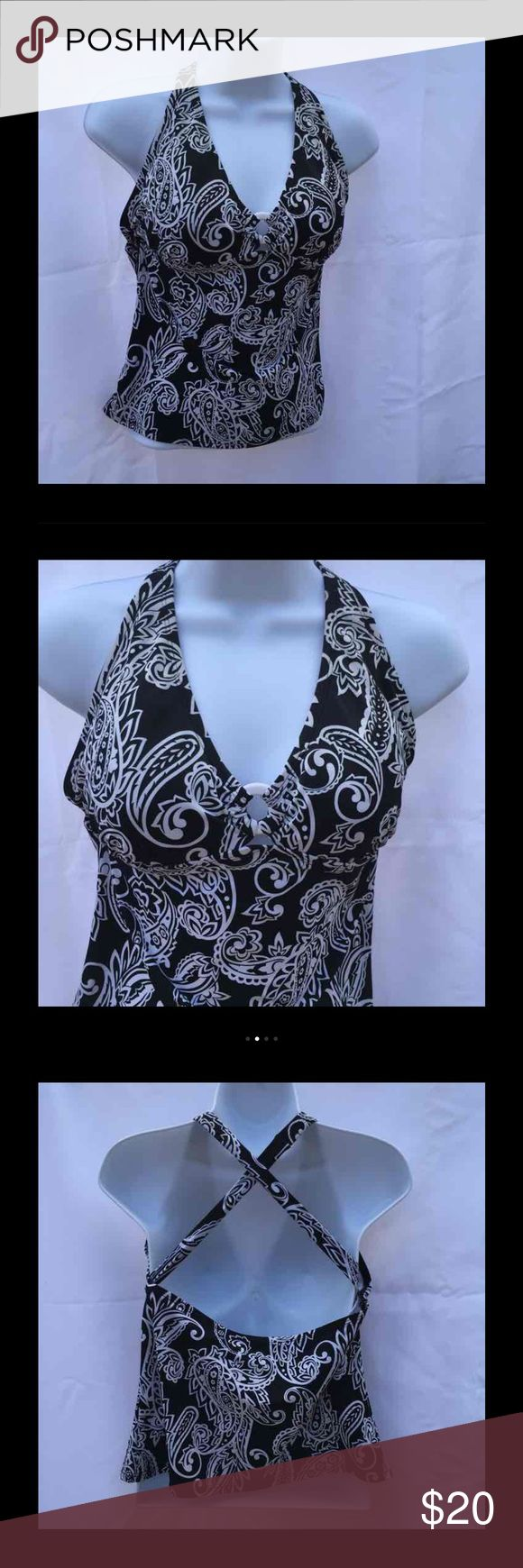 Very Versatile Jantzen Tankini Very versatile Jantzen Halter Tankini. Wear it with anything from shorts to bikini bottoms.  Padded cups  Halter style that crisscross in the back Ladies Medium  Black & White paisley print   TANKINI ONLY   EUC Non smoking environment  No stains, snags or damage   EUC Non smoking environment  No stains, snags or damage  Thanks , Molly M 638 / W .50 Jantzen Swim Bikinis