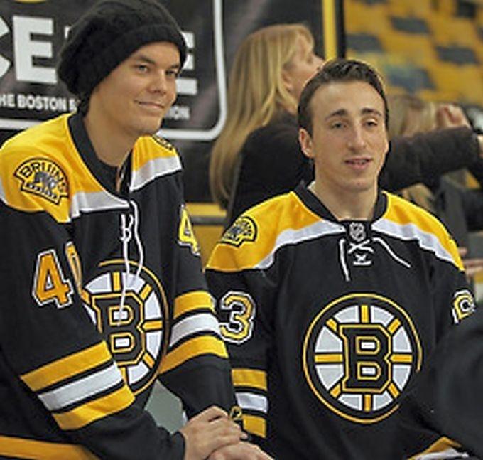 Tuukka Rask and Brad Marchand- Boston Bruins