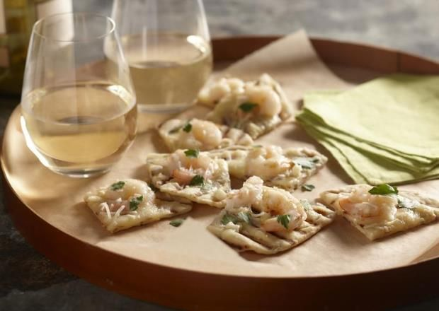 I found this recipe for Shrimp Scampi Grilled Pizzas on Herbed Crust, on Breadworld.com. You've got to check it out!