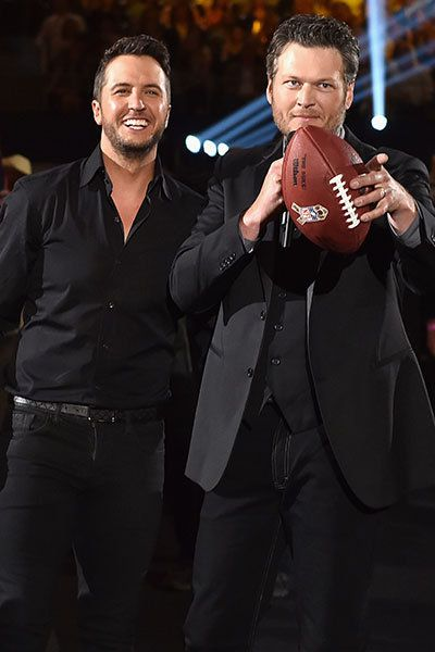 Luke Bryan (left) and Blake Shelton goof off while hosting the the 50th annual ACM Awards in Arlington, Texas, on April 19, 2015.