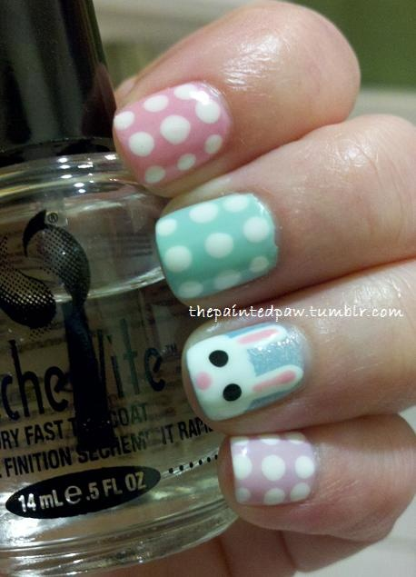 My Easter nail art! I love the cute little Bunny! I was sad when I had to take it off. The colors from top to bottom:  Revlon Colorstay - Cafe Pink (also used for the Bunny's ears and nose)  Essie - Mint Candy Apple  Sinful Colors - Cinderella  Revlon - Lilac Pastelle  Wet n Wild - French White Creme (all of the white)  Wet n Wild - Black Creme (Bunny's eyes)