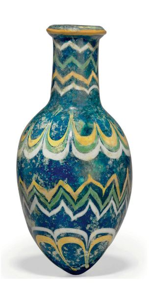 A MESOPOTAMIAN CORE-FORMED GLASS BOTTLE -  CIRCA MID TO LATE 15TH CENTURY B.C.
