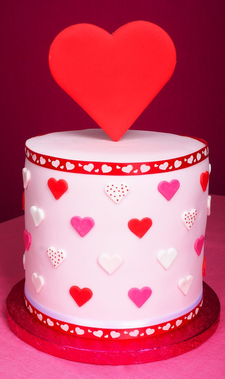 Pink Valentine cake with big red heart