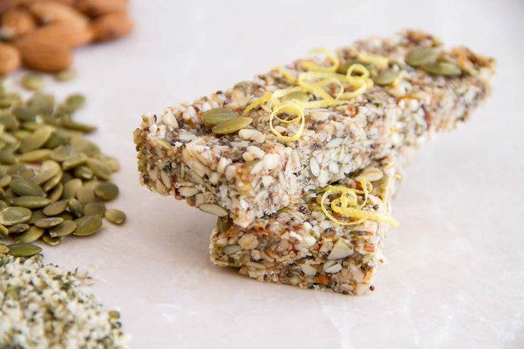RAW energy bars with lemon zest, chia, hemp seeds, pepitas, coconut and dates.  raw • dairy free • protein rich • healthy fats  ascensionkitchen.com