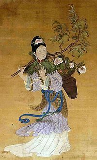 """Magu. An ancient female immortal, also called """"the Hemp Lady."""" Revered by the Complete Perfection sect of Daoism. Portrayed wearing a tiger-head pouch, a sword, and a head dress symbolizing the freedom of heaven, with wild hair and bird-like fangs."""