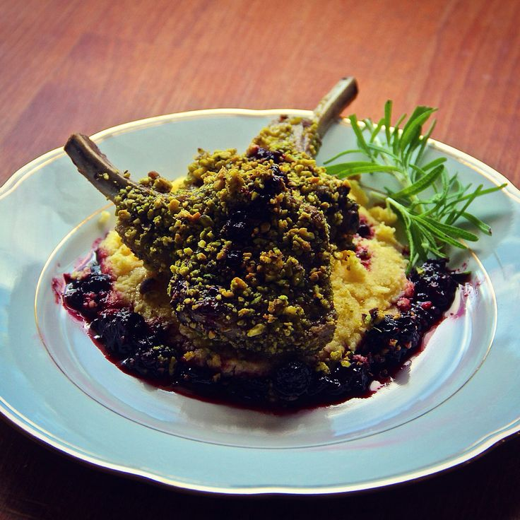 Baked pistachio crusted lamb chops on goat cheese polenta with a cherry port wine sauce