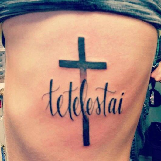 "Greek word Tetelestai- ""it is finished"" cross rib tattoo"