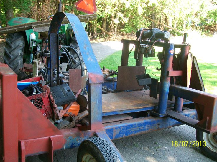 Cable winches log in to clamp. Hydraulic chainsaw cut block that falls into splitter.  http:/onefacecord.com/store