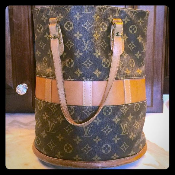 AUTHENTIC 70's VINTAGE LOUIS VUITTON BUCKET BAG SUPER cool and hard to find 70's vintage Louis Vuitton bucket bag with attached leather make up case. Somewhat worn as you can see by pictures as it is over 40 years old. A rare  find as not that many were made of this style Louis Vuitton Bags Shoulder Bags