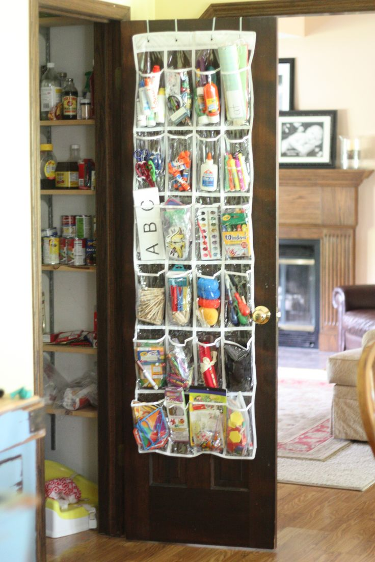 Over the door shoe organizer. This is how I stored my kids craft supplies years ago. It worked well in our small space. I kept things I didn't want them to reach up high.