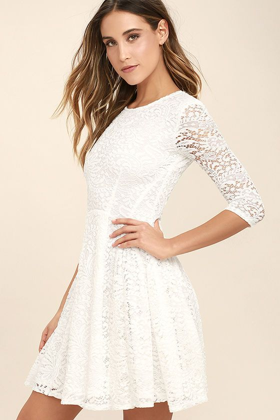 The It's a New Day White Lace Skater Dress is here to bring some cheer to your wardrobe! Lovely floral lace shapes a rounded neckline and sheer, three-quarter length sleeves. A fitted, darted bodice tops a full skater skirt for your twirling pleasure!