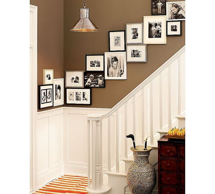 Love this photo display. We have the frames, just need a place to hang them all...