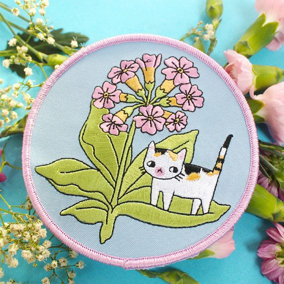 Embroidered plant kitty patches! Will liven up any garment <3 Measurements are (width x height) 4,3 x 4,3 inch or 11 x 11 cm. Comes on card backing. These patches have an iron-on adhesive layer on the back so are super easy to apply. Once applied, applique is permanently attached to your garment. How to apply: Set your hand iron at the hottest temperature setting. Do not use steam! Place your patch in the desired position and place a pressing cloth (such as a handkerchief, sheet or pillow...