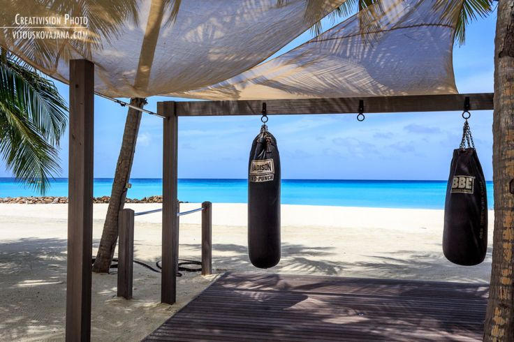 Punching bags on a beach One&Only Reethi Rah