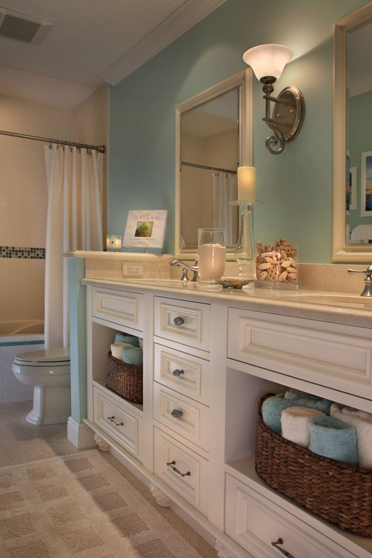 Beach Bathroom this is what I want. Love the shells and different colored towels in baskets.