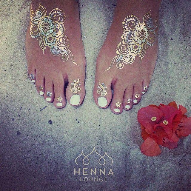 #HennaLounge / @nud_ink metallic tattoos in da house! Sneak peak phone pic. Going to be shooting them this week. #metallictattoo #goldhenna #silverhenna #flashtattoos #bling #sorrymypedicureisold #toes #sand #beachlife #Tulum #Mexico