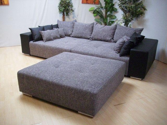 huge couch. Can I get this in white or completely black?