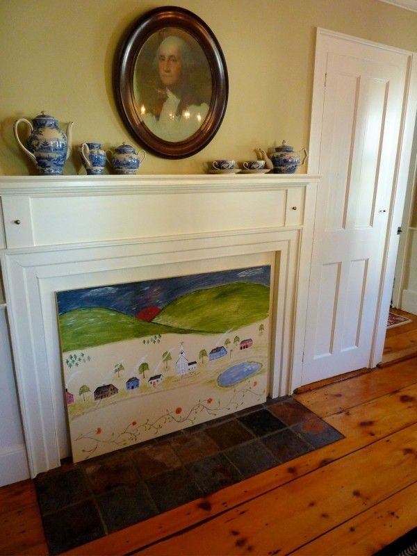 Cover An Unused Fireplace With A Large Painting