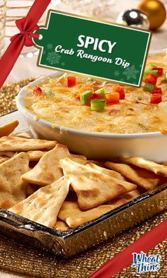 """Add some """"kick"""" to your holiday party with this creamy Spicy Crab Rangoon Dip, bursting with savory cheese and pepper flavor. Best served alongside WHEAT THINS Toasted Pita Original Oven Baked Crackers. Takes only 10 minutes to prep!"""