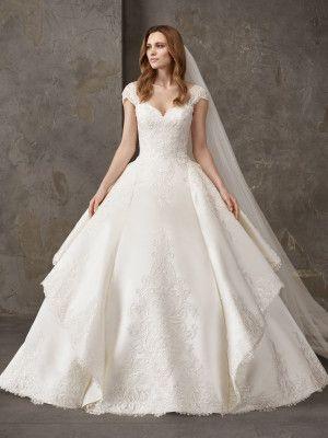 vestido-de-novia-de-falda-princesa-con-volantes-asimetricos